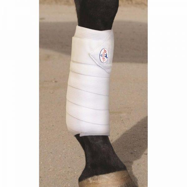 bandes de travail combinées élastiques et polaire Professional's choice posé sur un cheval
